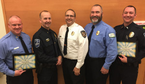 Chris Matek (far L) and Brian Kramer (far R) receive the Making A Difference award from Northfield Police Chief Monte Nelson, Lonsdale Fire Department Captain Scott Sticha and Brian Edwards of Northfield Hospital & Clinics EMS.